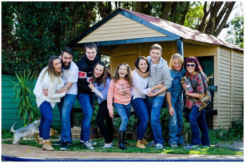 Germiston Family photography at home on location. Gauteng Family photographer with large family photography and natural fun posing. Family photography using pets and home in the East Rand