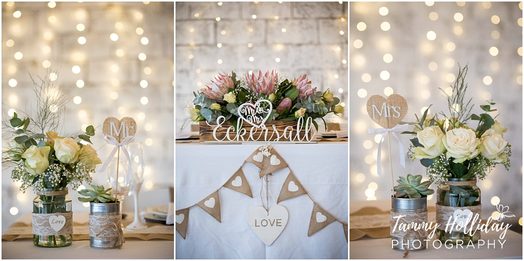 wedding laser cutout surname, bride and groom main table in front of fairy lights