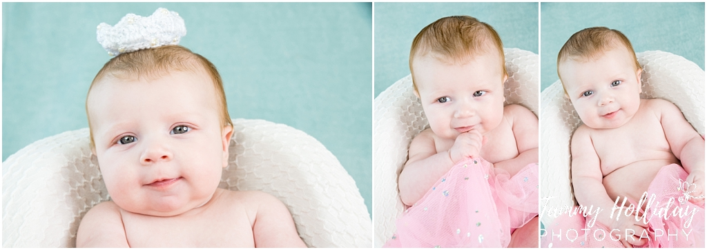 baby in pink tutu with blue background