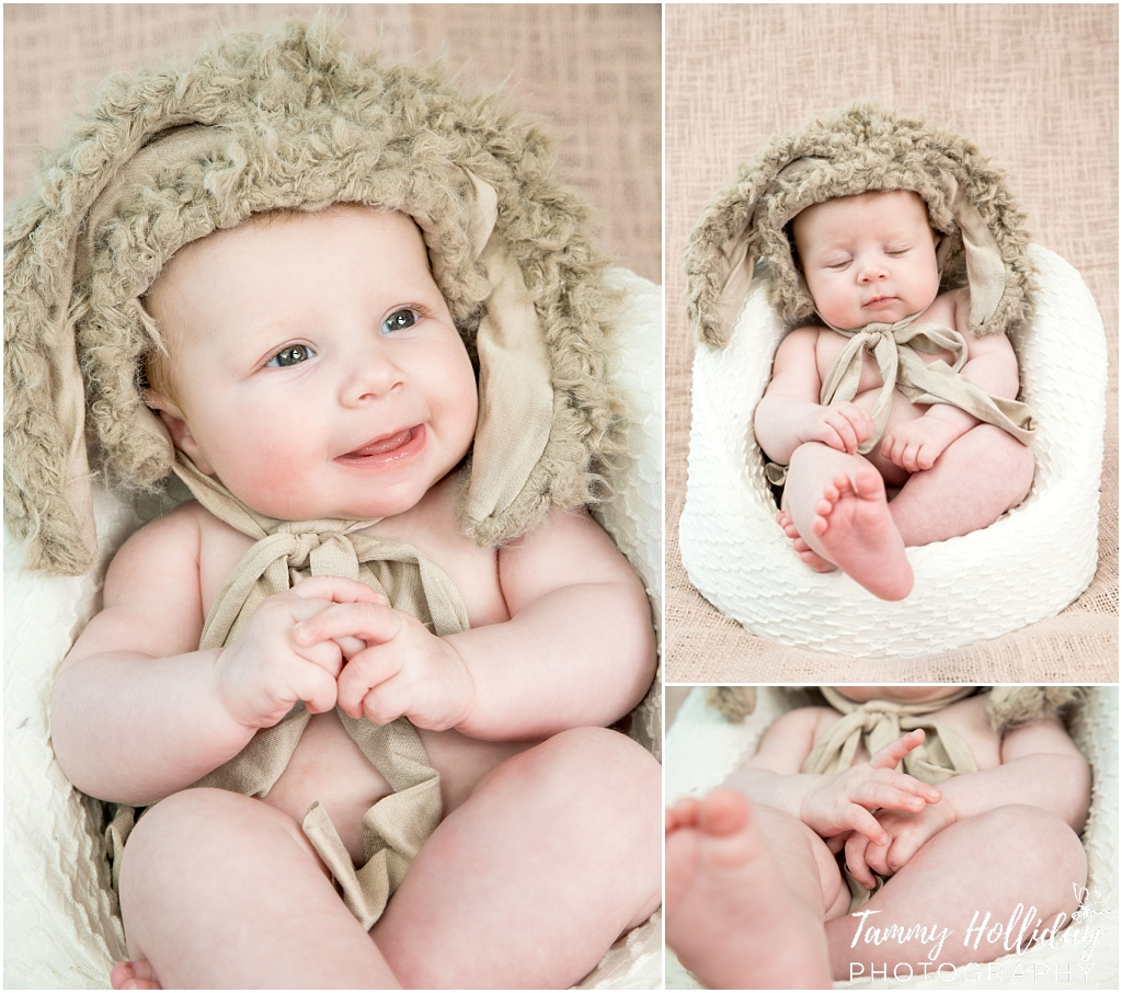 cute baby wearing brown fuzzy bunny ear hat with brown background in studio photo shoot