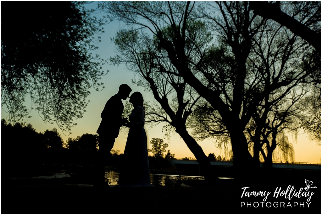 sunset kiss bride and groom silhouhette