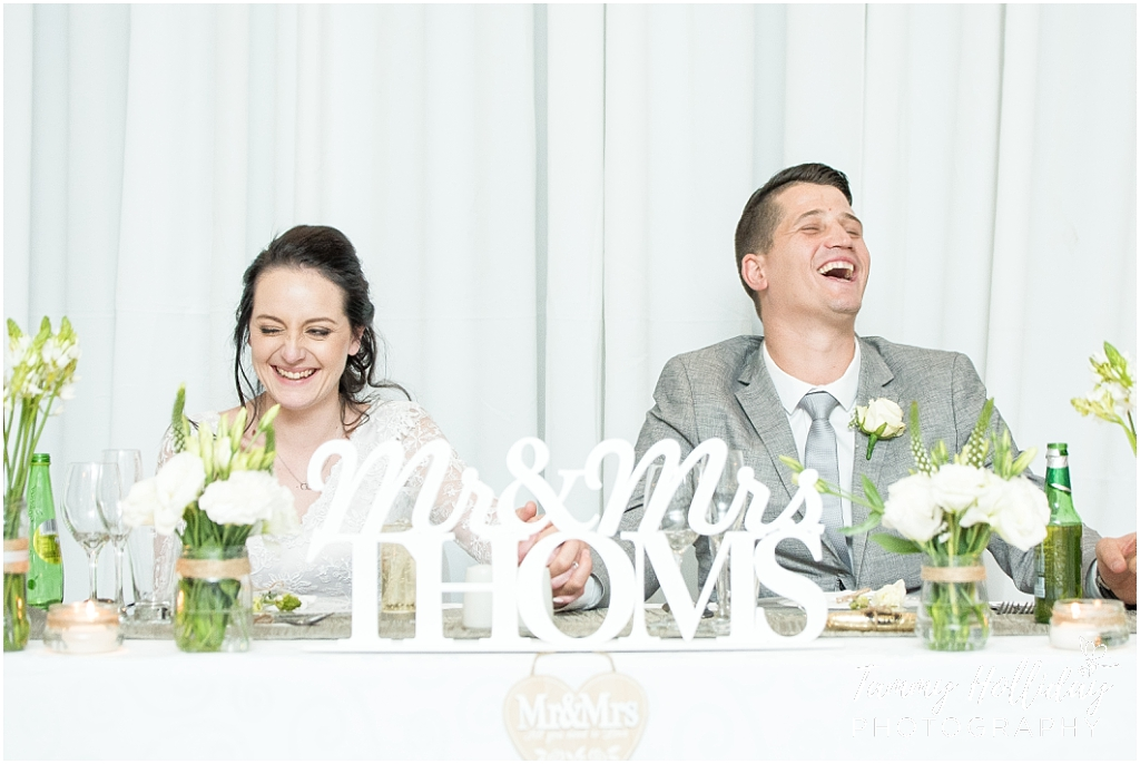 laughing bride and groom at main table