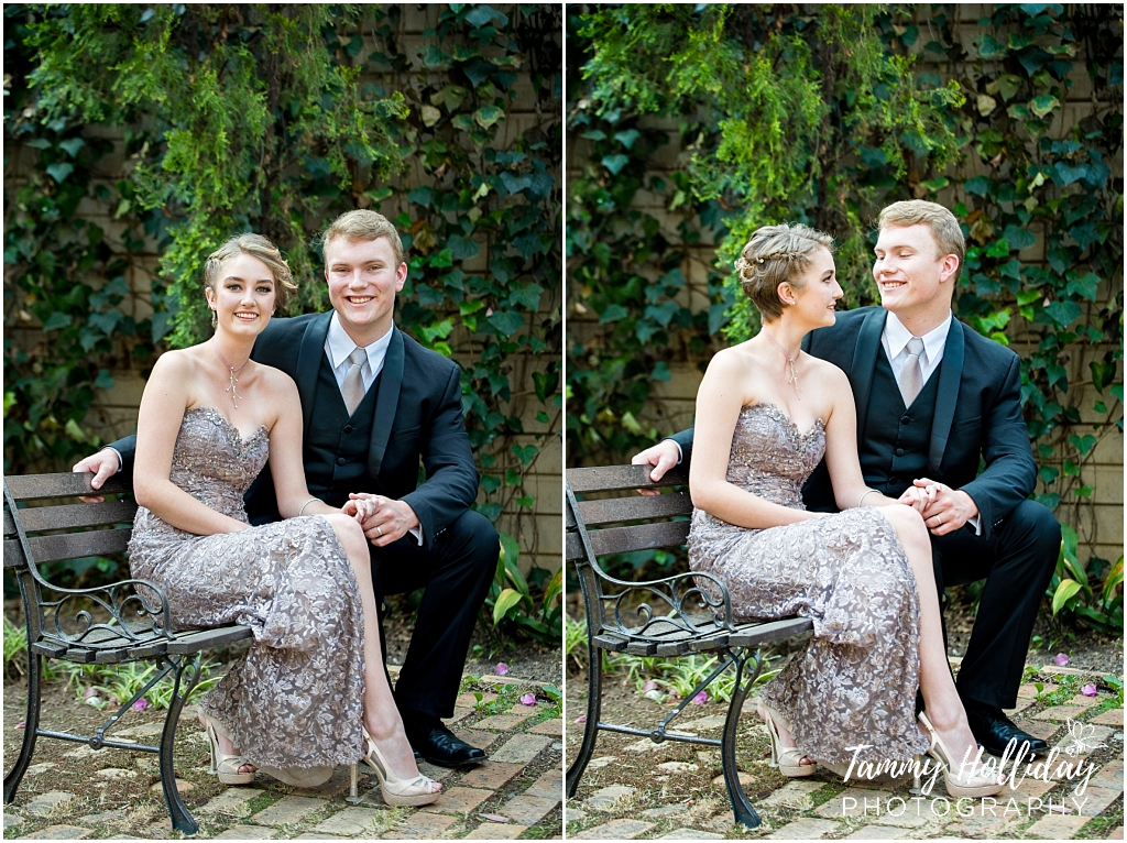 matric couple sitting in garden on a wooden garden chair on brick layout and greenery background
