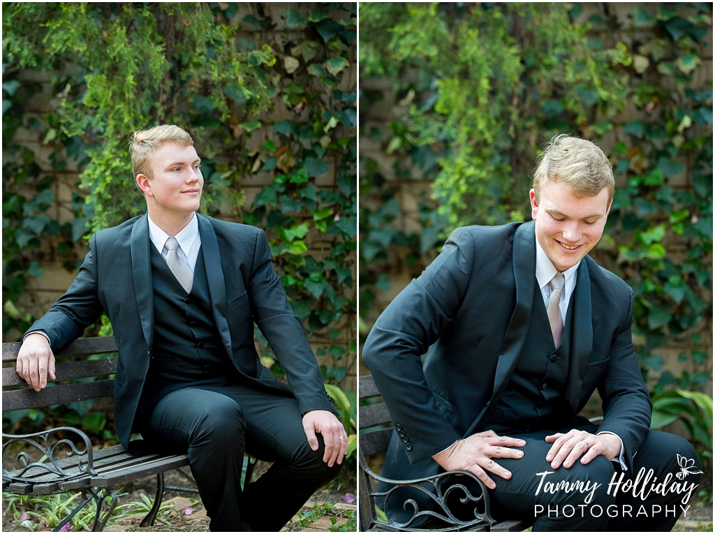 maric guy in black suit sitting on wooden chair in garden