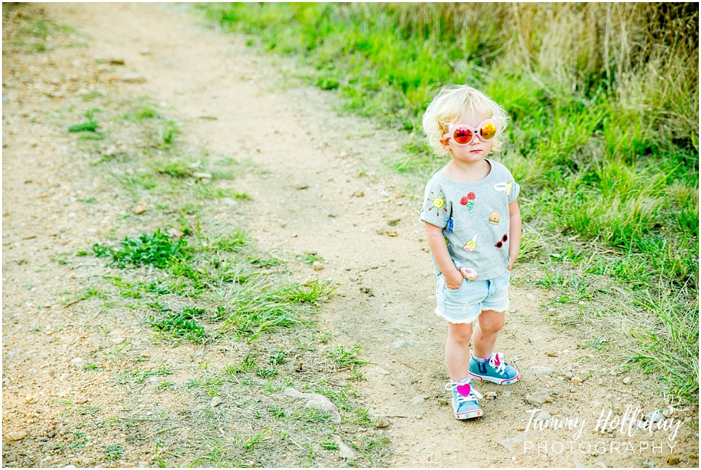 cool kid wearing shades on sand road