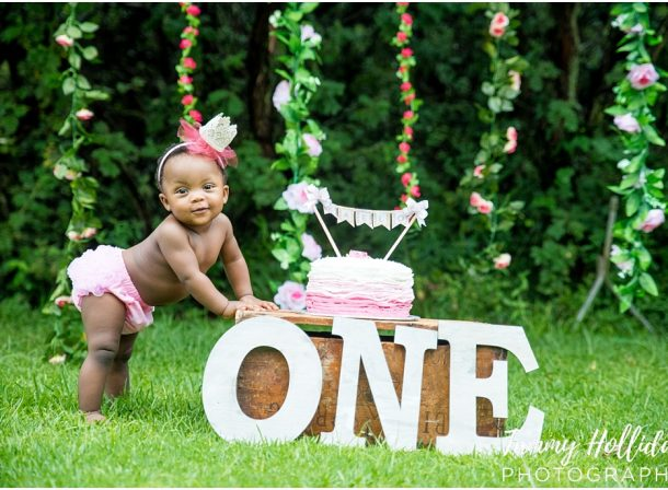 cake smash photo shoot on location greenery background first birthday photo shoot