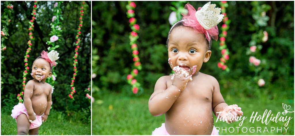 cake smash photo shoot first birthday photographer on location little girl eating smashed cake wearing pink crown headband