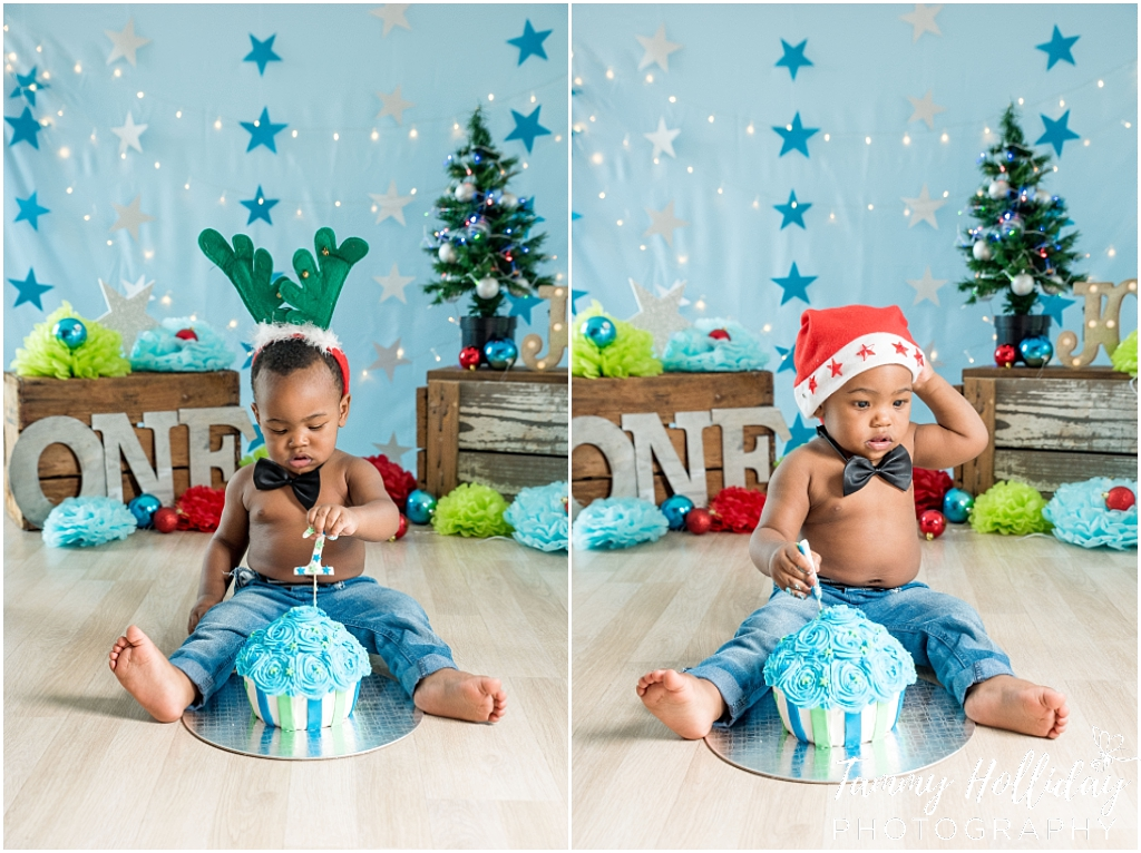 cake smash photographer 1st birthday photoshoot christmas hats little boy with blue stars background christmas theme bow tie blue cake studio shoot