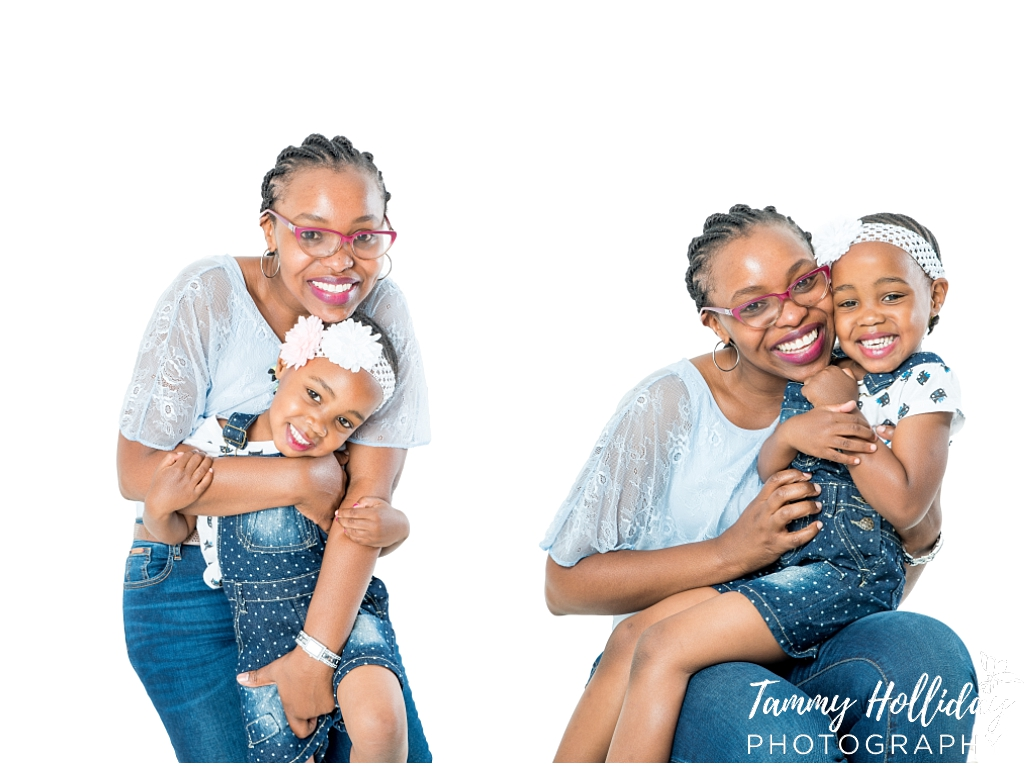 mother and daughter wearing blue denim white background mom hugging daughter family photoshoot studio photoshoot