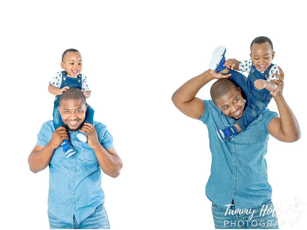 father and son shoot son on fathers shoulders wearing blue denim with white background studio shoot family photoshoot
