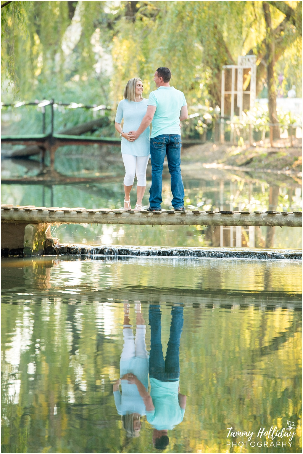 Heavensgate Maternity Session, photos on a bridge over a river with a reflection
