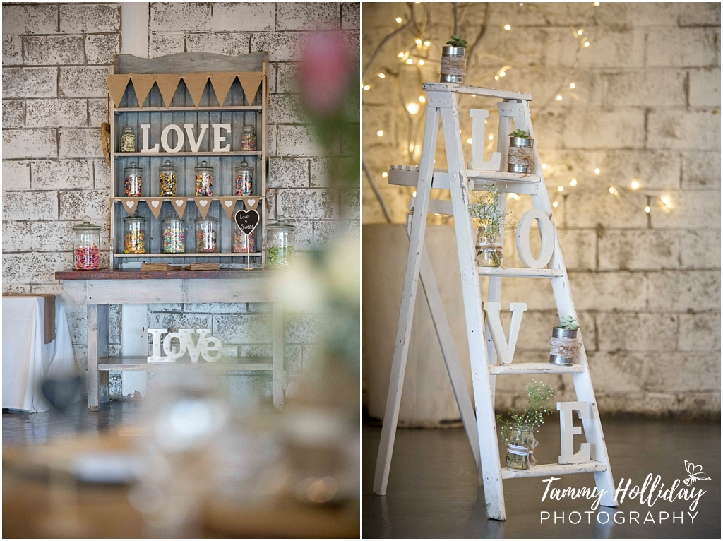 really cool candy bar at a wedding, with a naked cake and hessian bunting or flagstring