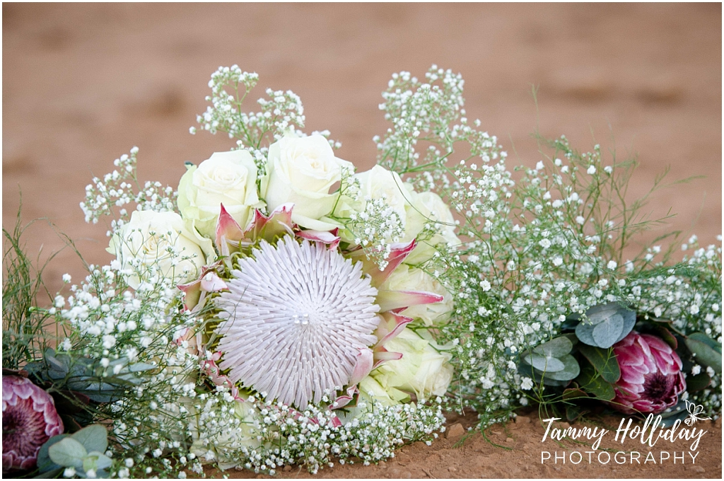 Protea and babys breathe flower bouqet
