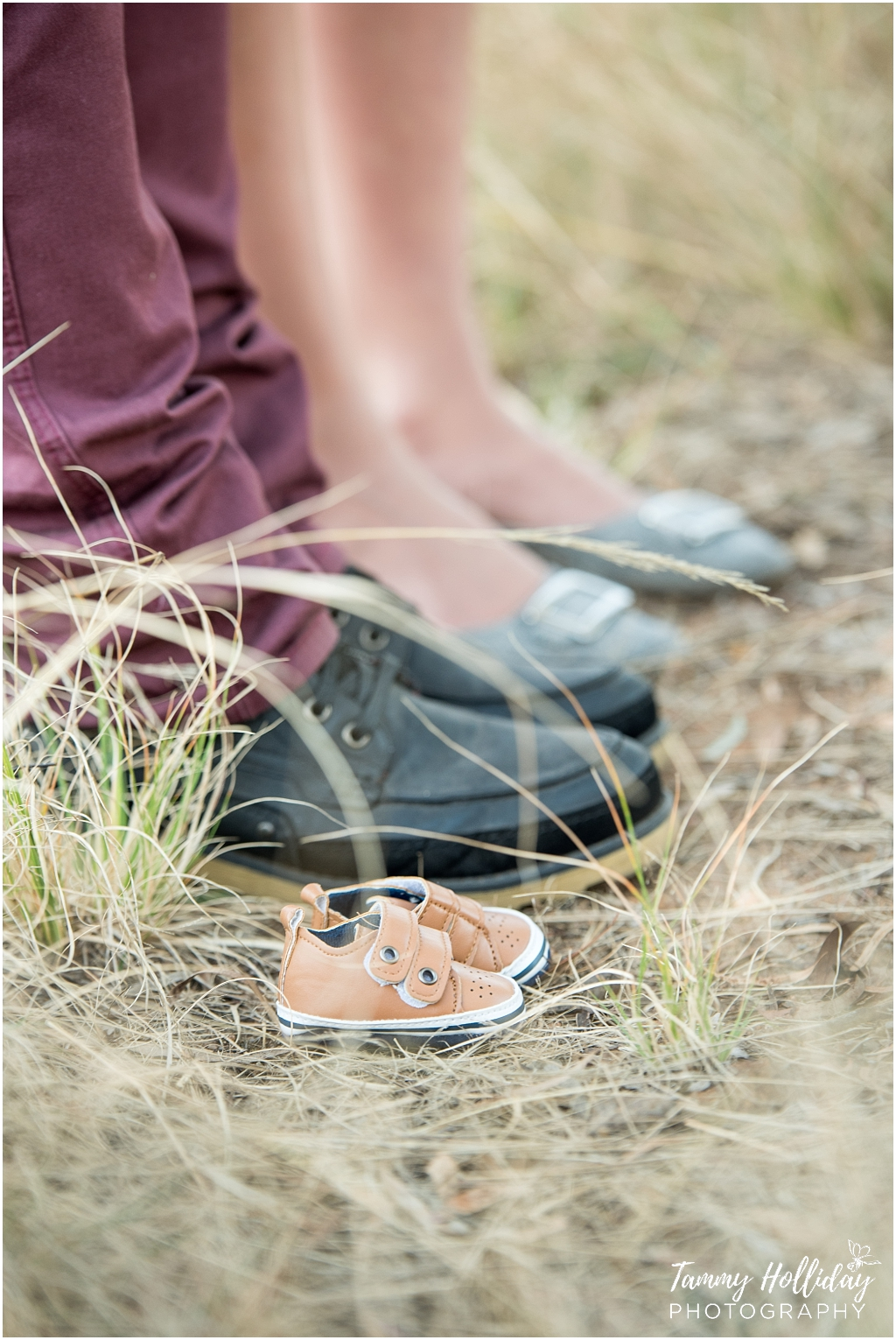 maternity shoot of baby shoes with parents shoes