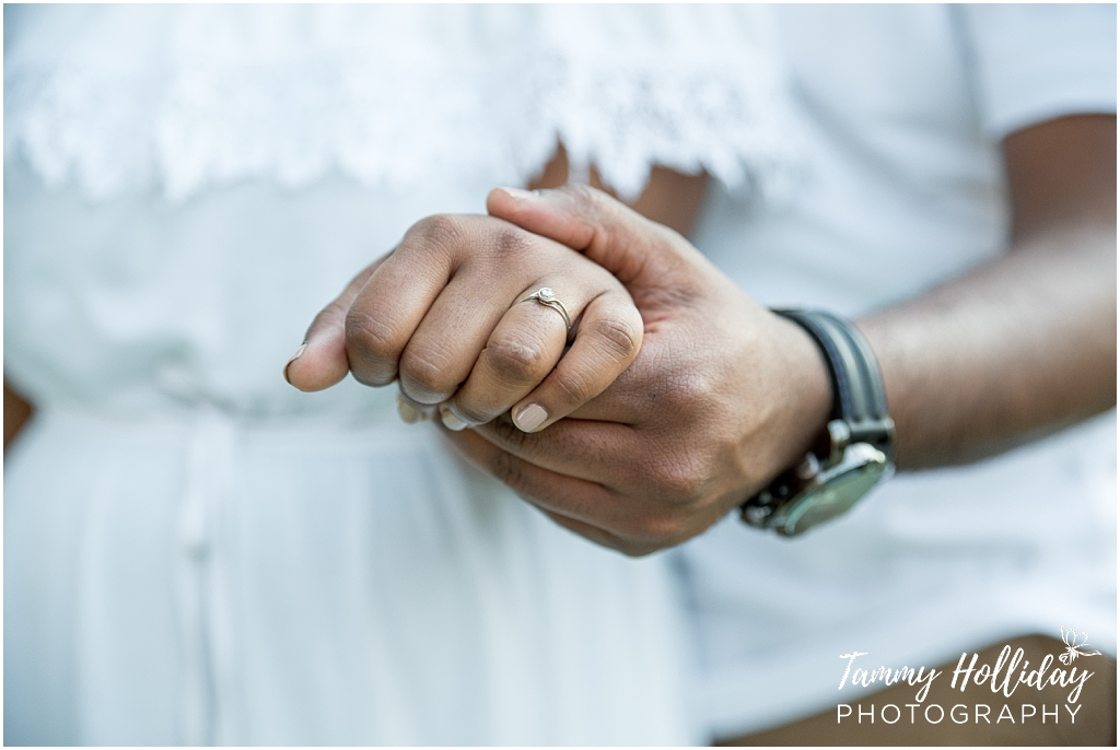 holding hands engagement ring couple e-shoot