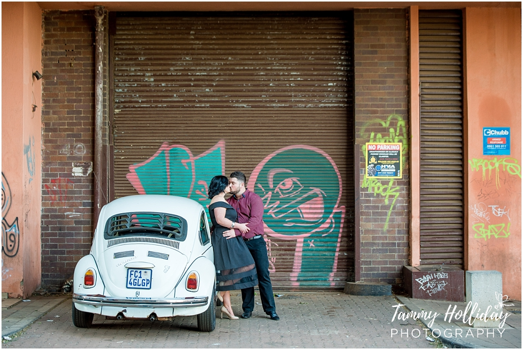 couple kissing by old vw beetle new town