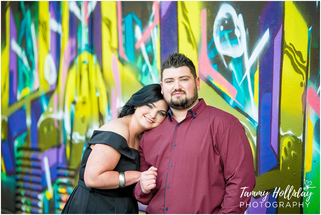 happy couple with graffiti background