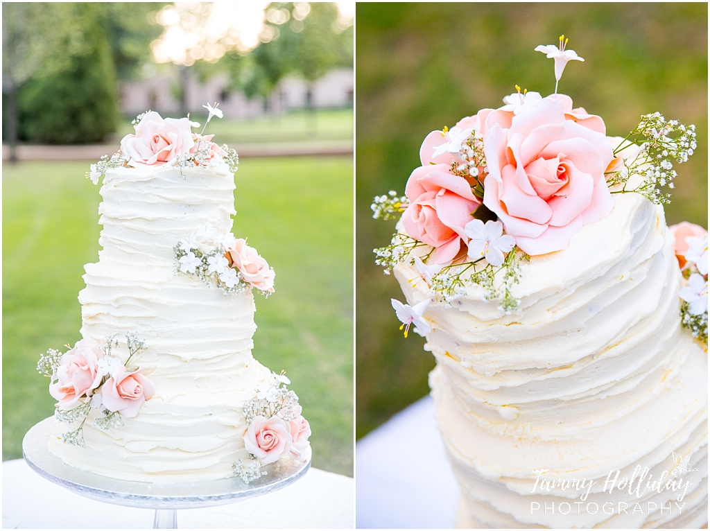 white wedding cake with pink flowers on