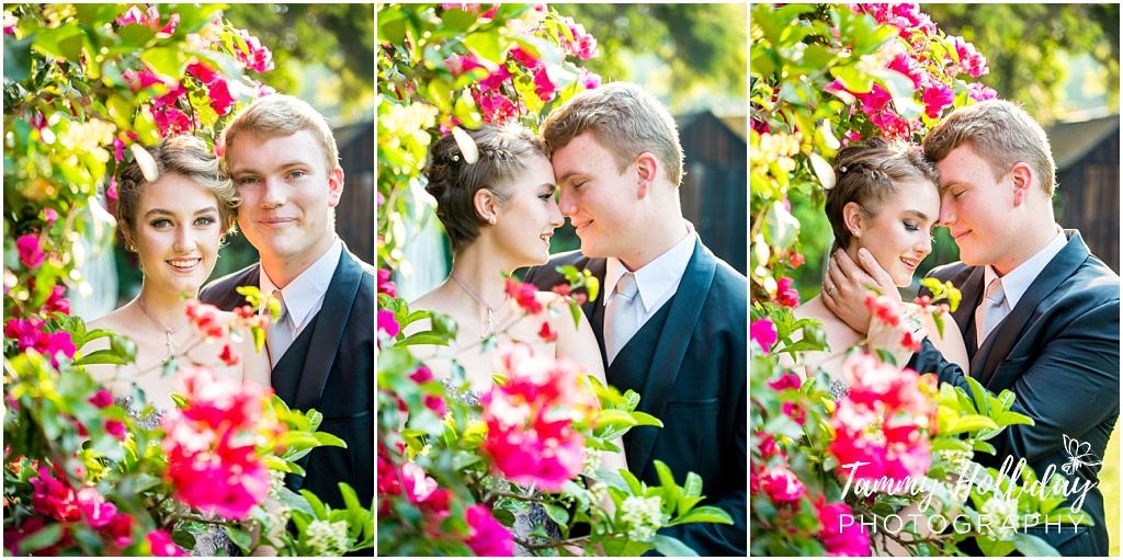 couple in between pink flowers in garden