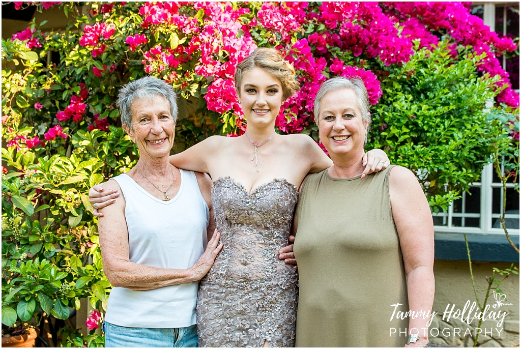 matric girl in garden with mom and gran