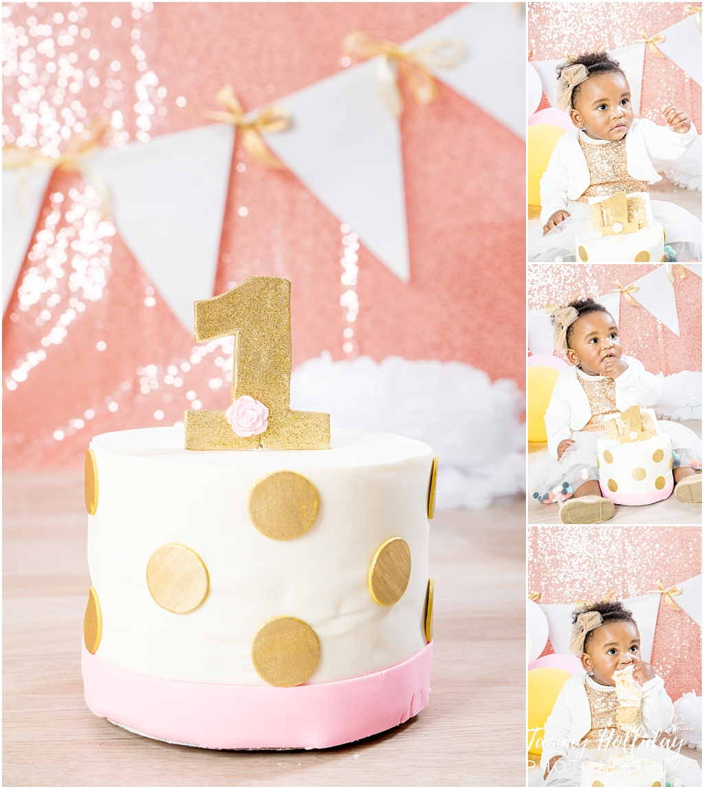 gold polka dot cake with 1 on pink sequence background and bunting