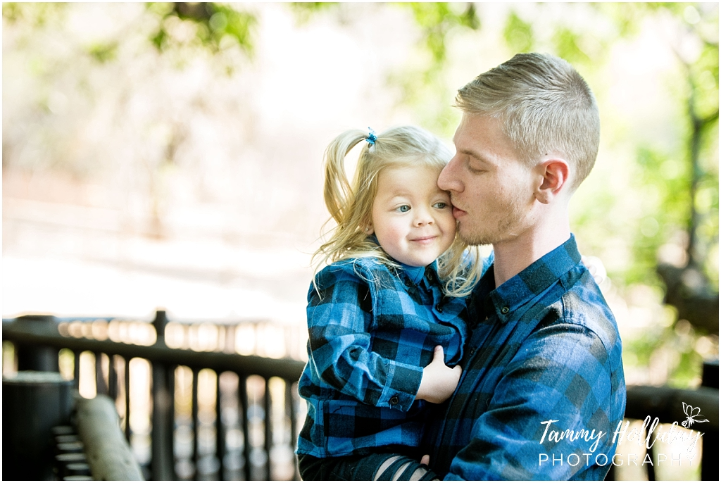 dad holding daughter wearing blue and black checkered shirts kempton park photographer on location