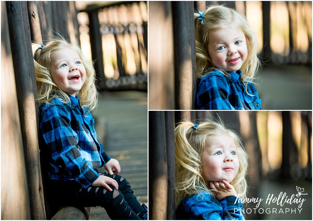 little girl laughing and smiling wearing black and blue checkered shirts
