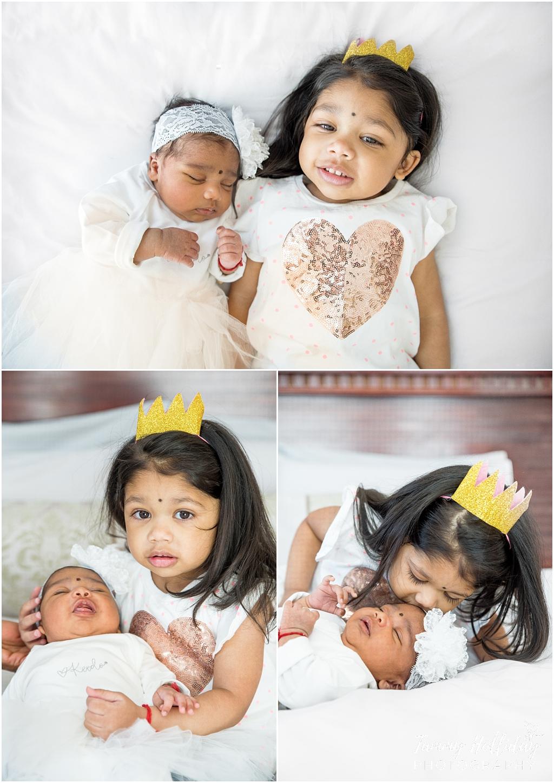 big sister holding baby sister