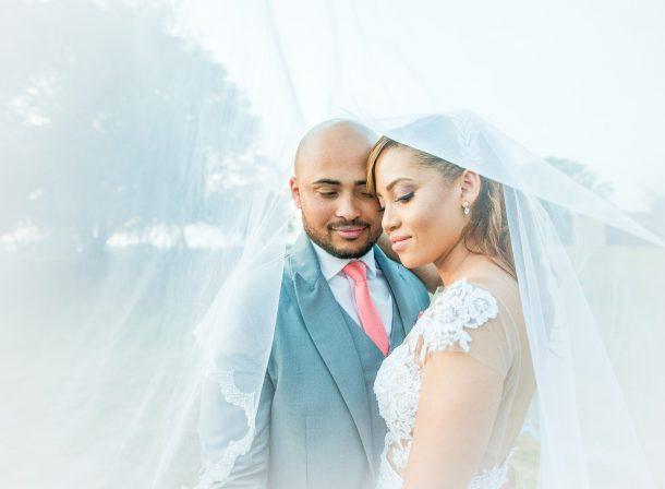 Oakfield Farm Wedding with bride and groom under a veil